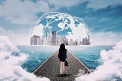 Woman walking toward the global business Royalty Free Stock Image
