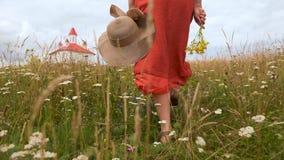 Woman walking toward small chapel on hill top