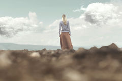 Woman walking towards infinity in a magical and surreal place Royalty Free Stock Image