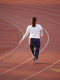 Woman Walking on Track Royalty Free Stock Image