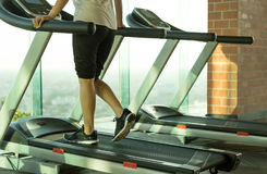 Woman walking on a treadmill exercise in the gym. In the morning Stock Photography