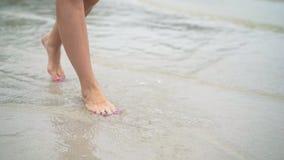 Woman walking on a tropical beach.  stock video