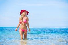 Woman walking on tropical beach Royalty Free Stock Photos
