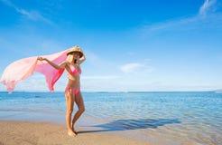 Woman walking on tropical beach Stock Image