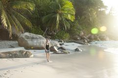 Woman walking on tropical beach royalty free stock photos
