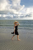 Woman Walking on a Tropical Beach Stock Photography