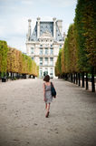 Woman walking in tuileries garden in Paris royalty free stock images
