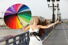 Woman walking with umbrella. Elegant woman walking on bridge with umbrella Royalty Free Stock Images