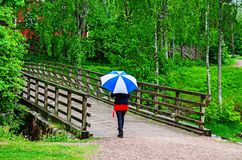 Woman walking with umbrella Royalty Free Stock Photography