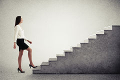Woman walking up concrete stairs Stock Photos
