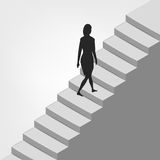Woman walking up on diagonal staircase Royalty Free Stock Photo
