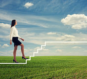 Woman walking up drawing white stairs Royalty Free Stock Photos