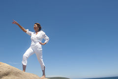 Woman walking up a hill Stock Photography