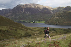 Woman walking up Red Pike in the Lake District Stock Photography