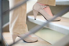 Woman walking up stairs Stock Photos