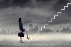 Woman walking up on stairs 3 Royalty Free Stock Images