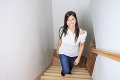 Woman Walking Up Stairs. A Woman Walking Up Stairs ofhis house Stock Photos