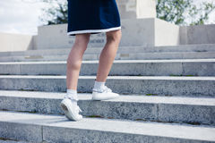 Woman walking up steps of memorial Stock Photography