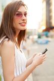Woman walking and using a smart phone Stock Photos
