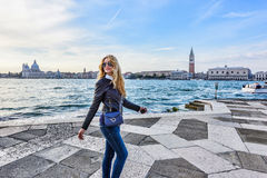 Woman walking in Venice Italy. Traveler or tourist girl exploring the city Royalty Free Stock Photos