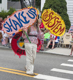 Woman walking in the Wellfleet 4th of July Parade in Wellfleet, Massachusetts. Stock Photos
