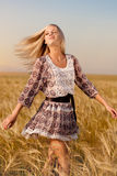 Woman walking on wheat field Royalty Free Stock Photos