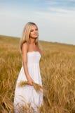 Woman walking on wheat field stock photos