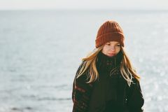 Woman walking at winter beach cold sea outdoor seasonal melancholy Lifestyle. Concept Royalty Free Stock Images