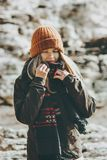 Woman walking at winter beach Travel Fashion Lifestyle concept outdoor. Girl wearing warm hat and scarf cold weather Stock Image