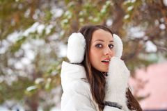 Woman walking in winter park Stock Photos