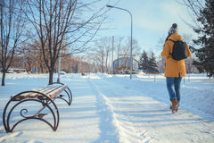 Woman walking in winter park Stock Images