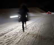 Woman walking on winter road Royalty Free Stock Photography