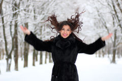 Woman walking in winter snow-covered park Stock Photography
