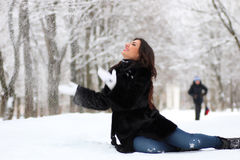 Woman walking in winter snow-covered park Stock Images