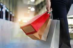 Free Woman Walking With Shopping Bags On Shopping Mall Background Stock Photography - 91186652