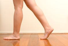 Woman walking on wooden floor Royalty Free Stock Images