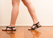 Woman walking on wooden floor Royalty Free Stock Photo