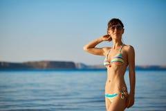 Woman walkingon the beach Royalty Free Stock Photos