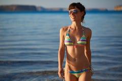Woman walkingon the beach Royalty Free Stock Image