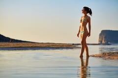 Woman walkingon the beach Stock Photos