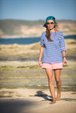Woman Walks Alone on a Deserted Beach Royalty Free Stock Image