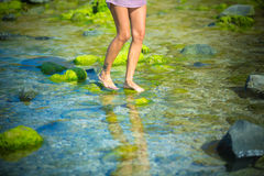 Woman Walks Alone on a Green Reef Royalty Free Stock Image