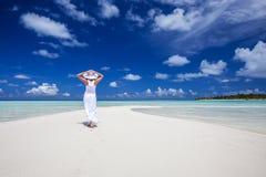 Woman walks along beautiful seashore Stock Image