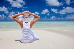 Woman walks along beautiful seashore Royalty Free Stock Photography