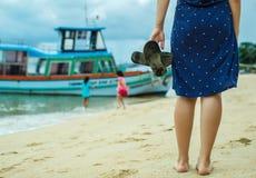 Woman walks along the seashore Royalty Free Stock Photo