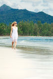 Woman walks on a beach Stock Photography