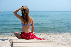 Woman walks at the beach Royalty Free Stock Photography