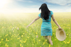 Woman walks on blossom meadow Stock Photography