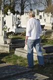 Woman walks through an cemetery Royalty Free Stock Photography