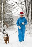 Woman walks with dog Stock Images